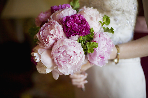 Bride holding bouquet of peony flowers Photograph by Elisa Cicinelli