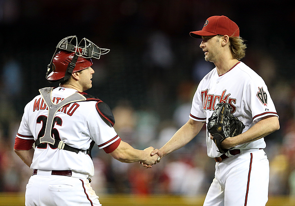 Bronson Arroyo And Miguel Montero Photograph by Christian Petersen