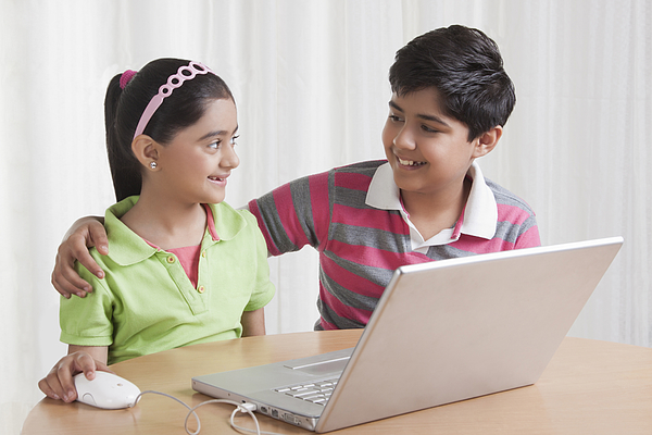 Brother and sister with laptop Photograph by Sudipta Halder