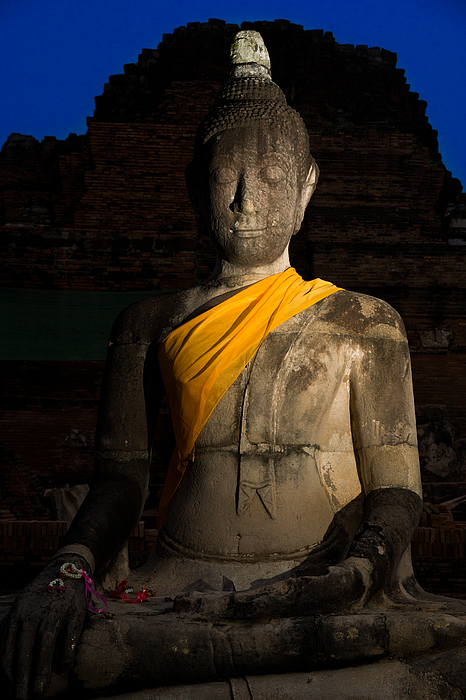 Buddha Image sitting silently in the dark Photograph by Lifeispixels