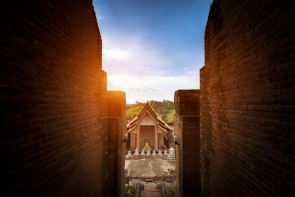 Buddha Temple and monk in Ayuthaya Historical Park, a UNESCO world heritage site in Thailand. Photograph by Chain45154