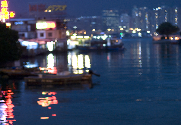 Burred lights reflected in harbour water Photograph by Lyn Holly Coorg