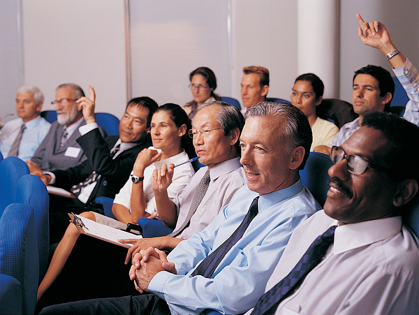 Business Executives in a Conference Room Asking Questions Photograph by Digital Vision.