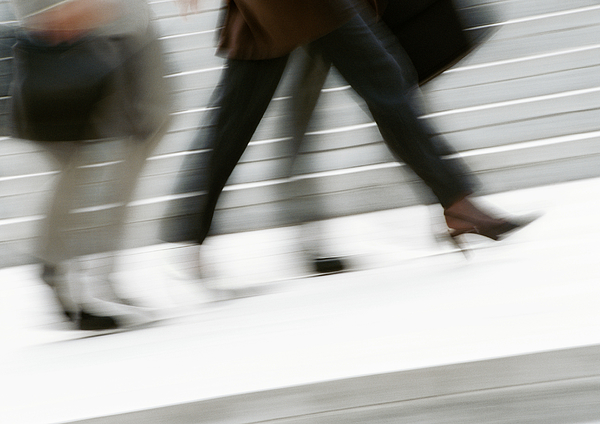 Business People Walking In Street, Low Section, Blurred Photograph by Eric Audras
