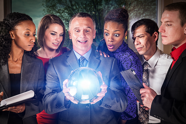 Business Team with Crystal Ball Photograph by Avid_creative