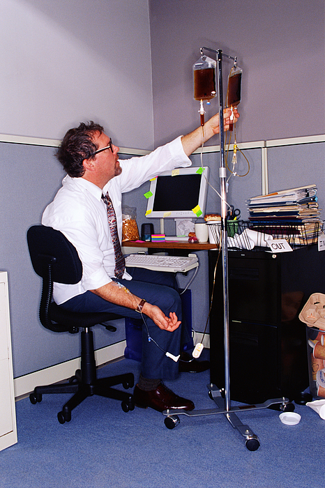 Businessman at messy desk with coffee IV Photograph by Thinkstock