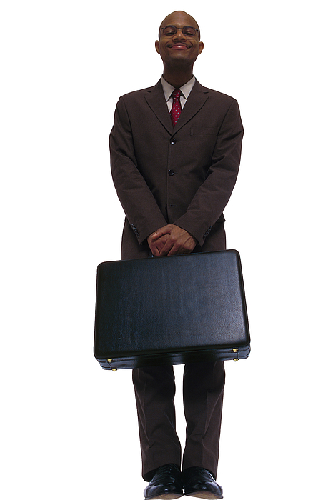 Businessman Posing With Briefcase Photograph by Comstock