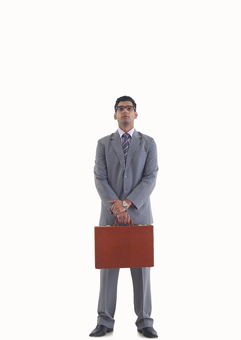 Businessman standing with suitcase Photograph by Abhinandita Mathur