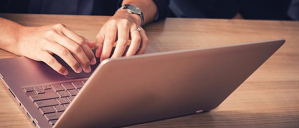 Businessman Working With Laptop In Seminar Room Photograph by Prasert Krainukul