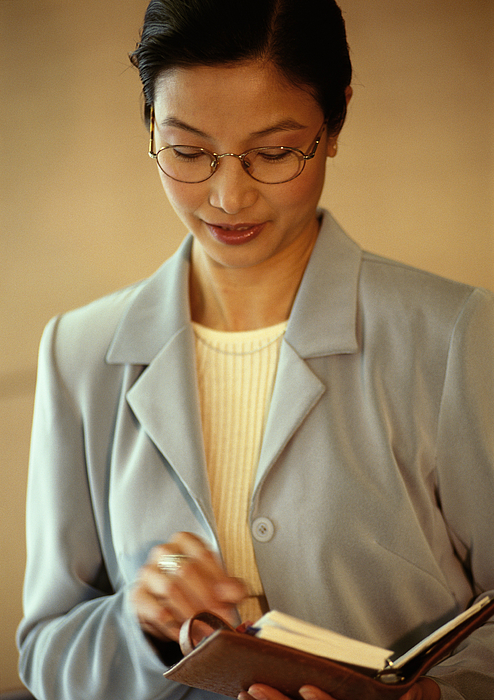 Businesswoman Holding Diary, Portrait Photograph by Eric Audras