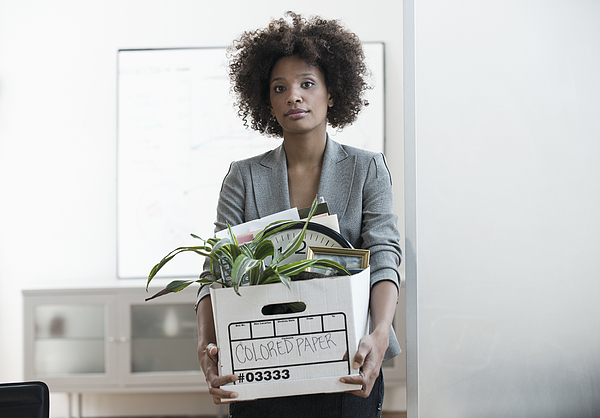 Businesswoman Packing Up Box In Office Photograph by Image Source RF/Cadalpe
