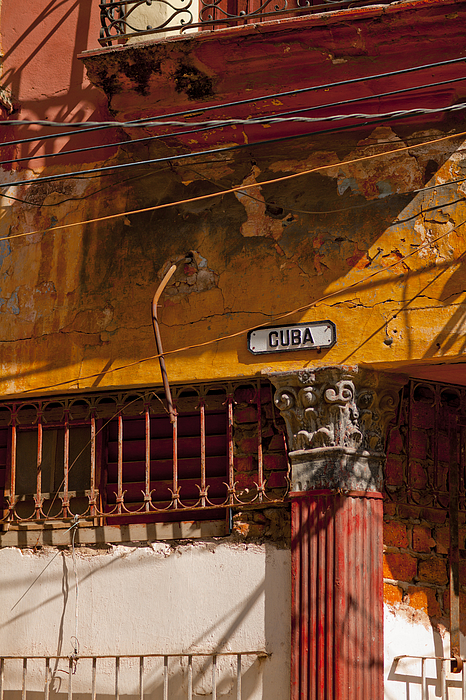 Calle Cuba sign on eroded wall Photograph by Merten Snijders