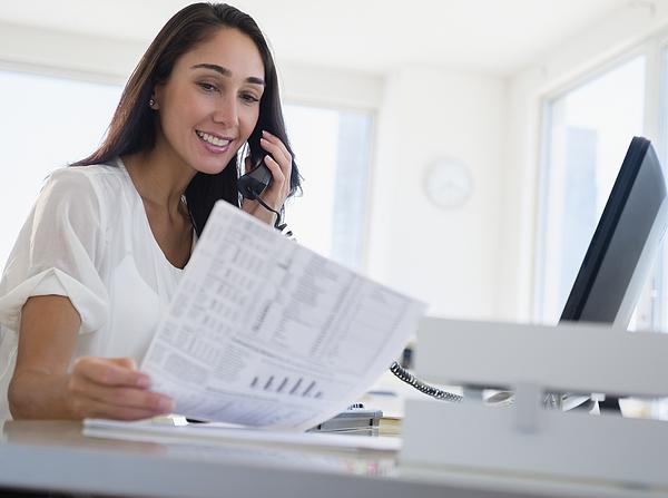 Caucasian businesswoman working at desk Photograph by JGI/Jamie Grill