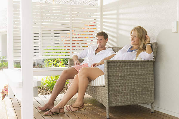 Caucasian couple relaxing on porch Photograph by Jacobs Stock Photography Ltd