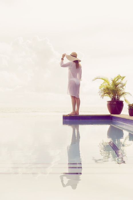 Caucasian woman admiring view from swimming pool Photograph by Jacobs Stock Photography Ltd