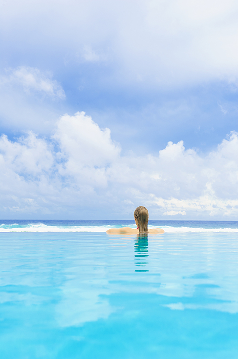 Caucasian woman in swimming pool Photograph by Jacobs Stock Photography Ltd