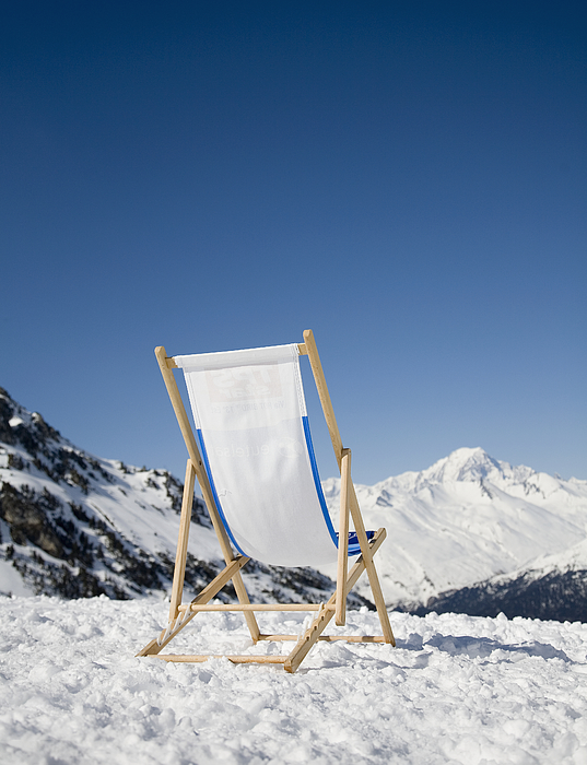 Chair in snow with view of French Alps Photograph by Ashley Jouhar