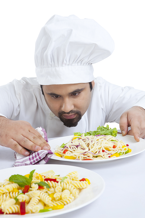 Chef cleaning side of plate Photograph by Ravi Ranjan