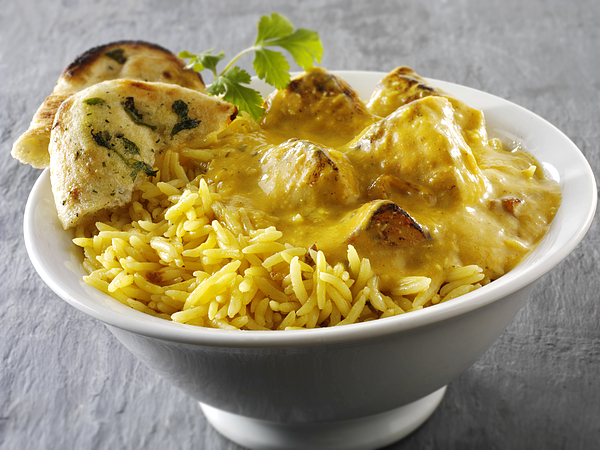 Chicken Passanda curry, pilau rice and naan bread Photograph by Paul Williams - Funkystock