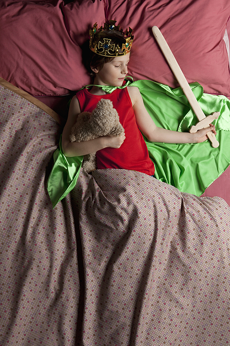 Child dressed as a king sleeping in bed Photograph by Vincent Besnault