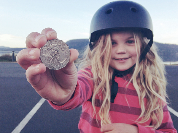 Child holding coin that she found on the ground Photograph by Jodie Griggs