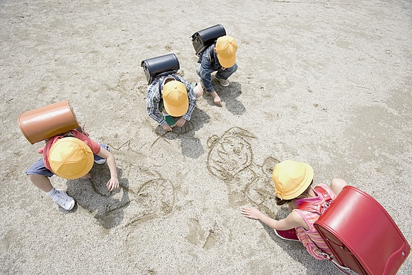 Children drawing in the sand Photograph by Image Source