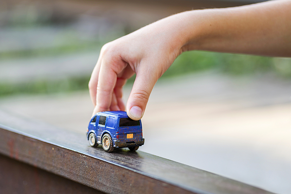 Children kid playing blue color car toy. Child hand playing with car Photograph by Andrii Zorii