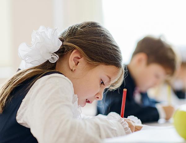 Children writing drawing in class Photograph by Tatiana Kolesnikova