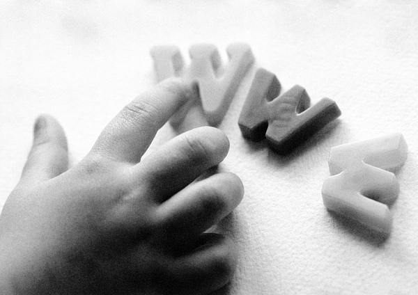 Childs Hand And Three Plastic Ws, Symbolizing World Wide Web. Photograph by Laurent Hamels