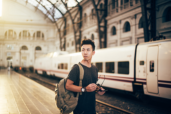 Chinese hipster man standing on station Photograph by South_agency