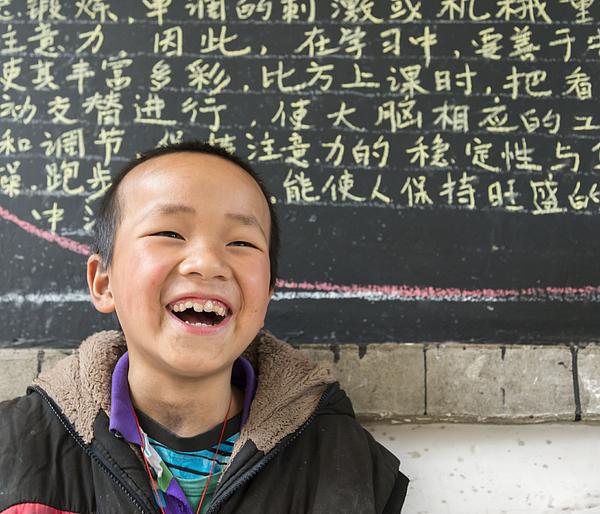 Chinese School boy, looking at camera, cheerful Photograph by Pidjoe