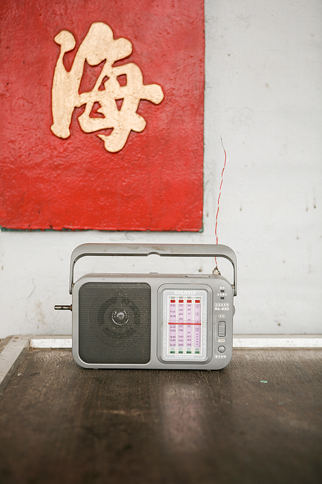 Chinese transistor radio on table Photograph by Merten Snijders