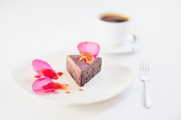 Chocolate dessert on plate with garnish and coffee, Grand Junction, Mesa County, Colorado, USA Photograph by Robb Reece