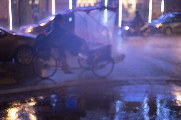 City street in the rain at night Photograph by Lyn Holly Coorg