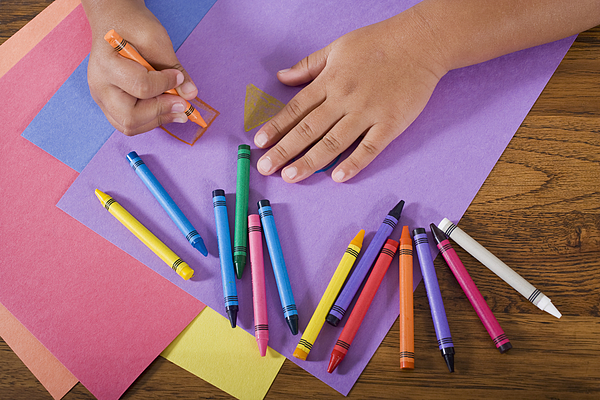 Close Up Hands Of Child Drawing With Colorful Crayons Photograph by Kali9