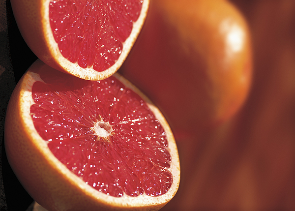 Close-up Of A Cut Open Grapefruit Photograph by Stockbyte