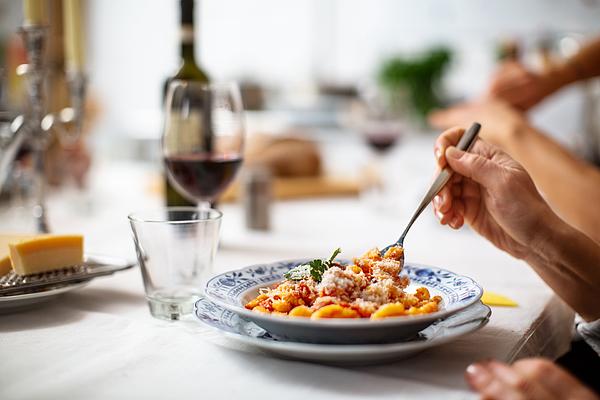 Close-up of a woman having pasta Photograph by Alvarez