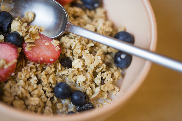Close-up of bowl of cereal and berries Photograph by Thinkstock Images