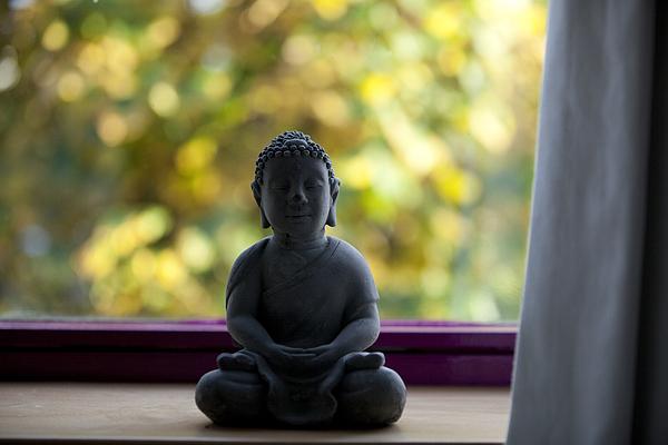 Close-Up Of Buddha Statue On Widow Sill Photograph by Paulien Tabak / EyeEm