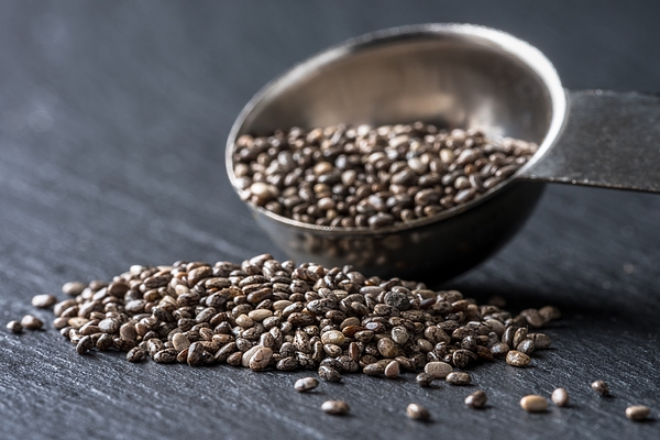 Close-Up Of Chia Seeds With Measuring Spoon On Wooden Table Photograph by Michelle Arnold / EyeEm