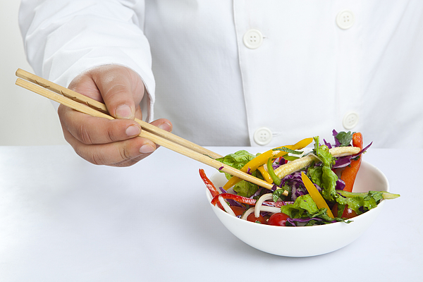 Close-up of chopsticks in bowl Photograph by Ravi Ranjan