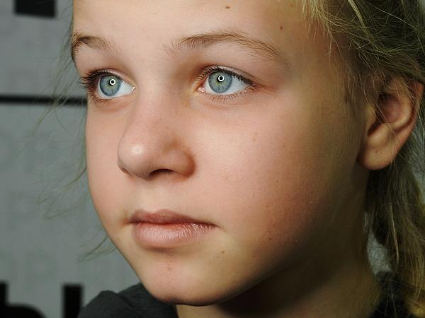Close-Up Of Girl Looking Away Photograph by Alexei Polyansky / EyeEm