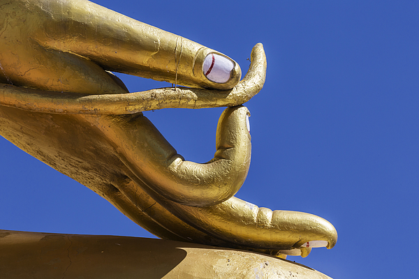 Close up of golden hand statue against blue sky Photograph by Jeremy Woodhouse