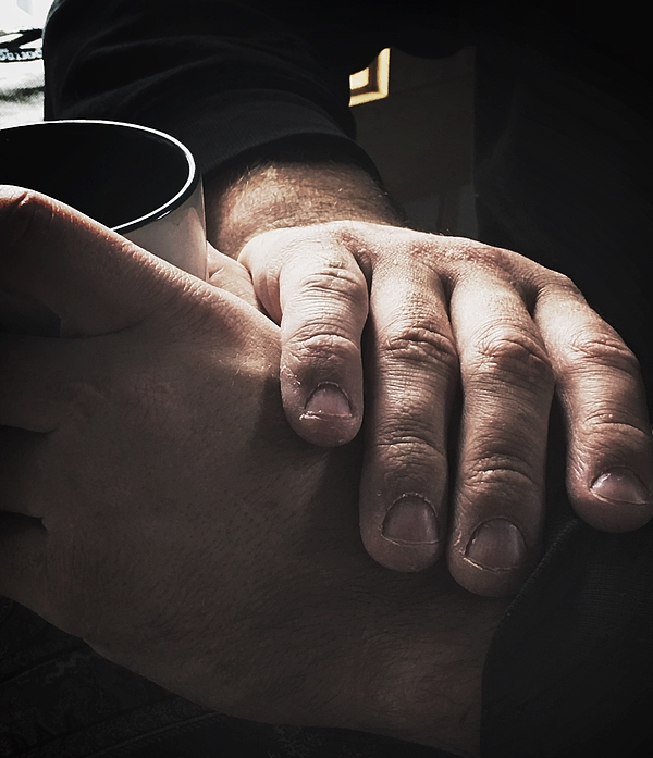 Close-up of hands holding mug Photograph by Amie Kennedy / FOAP