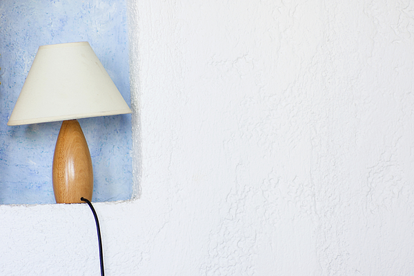 Close up of lamp in wall sconce Photograph by Chris Clor