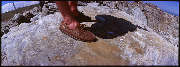 Close-Up Of Male Legs On Rocky Elevation Photograph by Willie Schumann / EyeEm