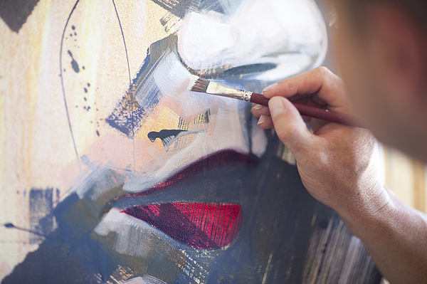 Close up of mature male artist working on canvas Photograph by Zero Creatives