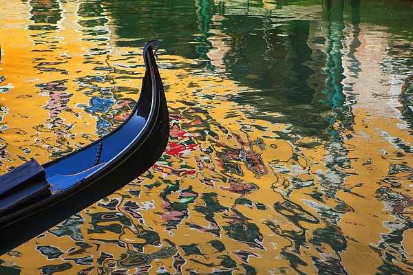 Close up of ornate gondola on canal Photograph by Chris Clor