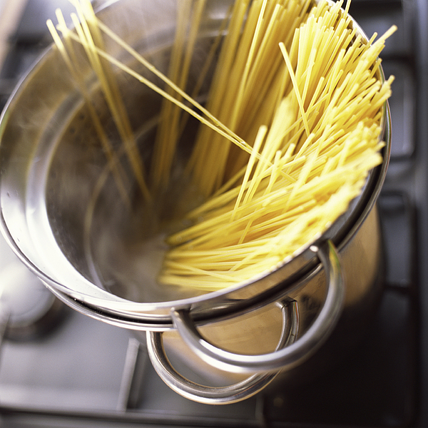 Close-up Of Pasta In Pot. Photograph by Jean-Blaise Hall