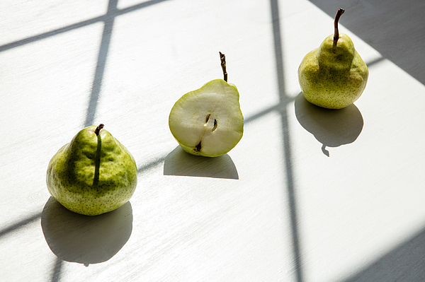 Close-Up Of Pears On Table Photograph by Piotr Marcinski / EyeEm